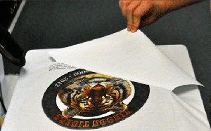 Peeling transfer paper from printed garment transfer